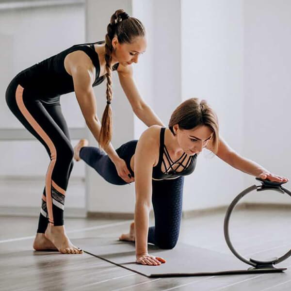 Instructor teaching Pilates in Edmonton studio